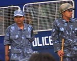 Nepali police stand infront of police van.
