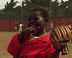 Boy playing baseball in Ghana