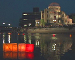 Lanterns floating in a Hiroshima river