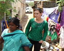 Reporter follows a woman inside the Chennai slum.