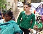 Reporter walking through Chennai slums.