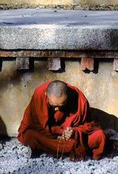Man sitting on the ground praying