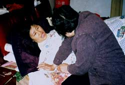 Dr. Gao Yaojie cares for AIDS patient