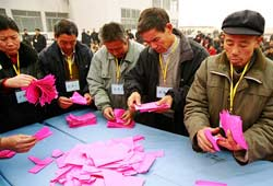 Officials counting ballots