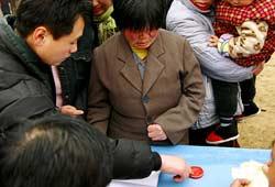 Voters register by giving their fingerprint