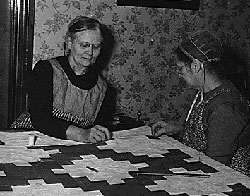 Amish women quilting, National Archives