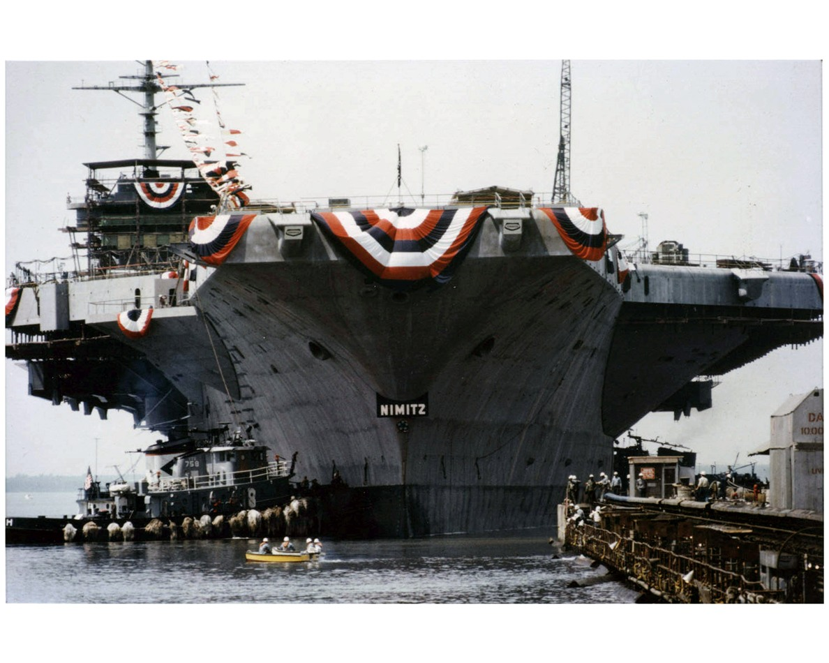 photo of the uss nimitz displaying ceremonial banners at the newport news shipyard in virginia on