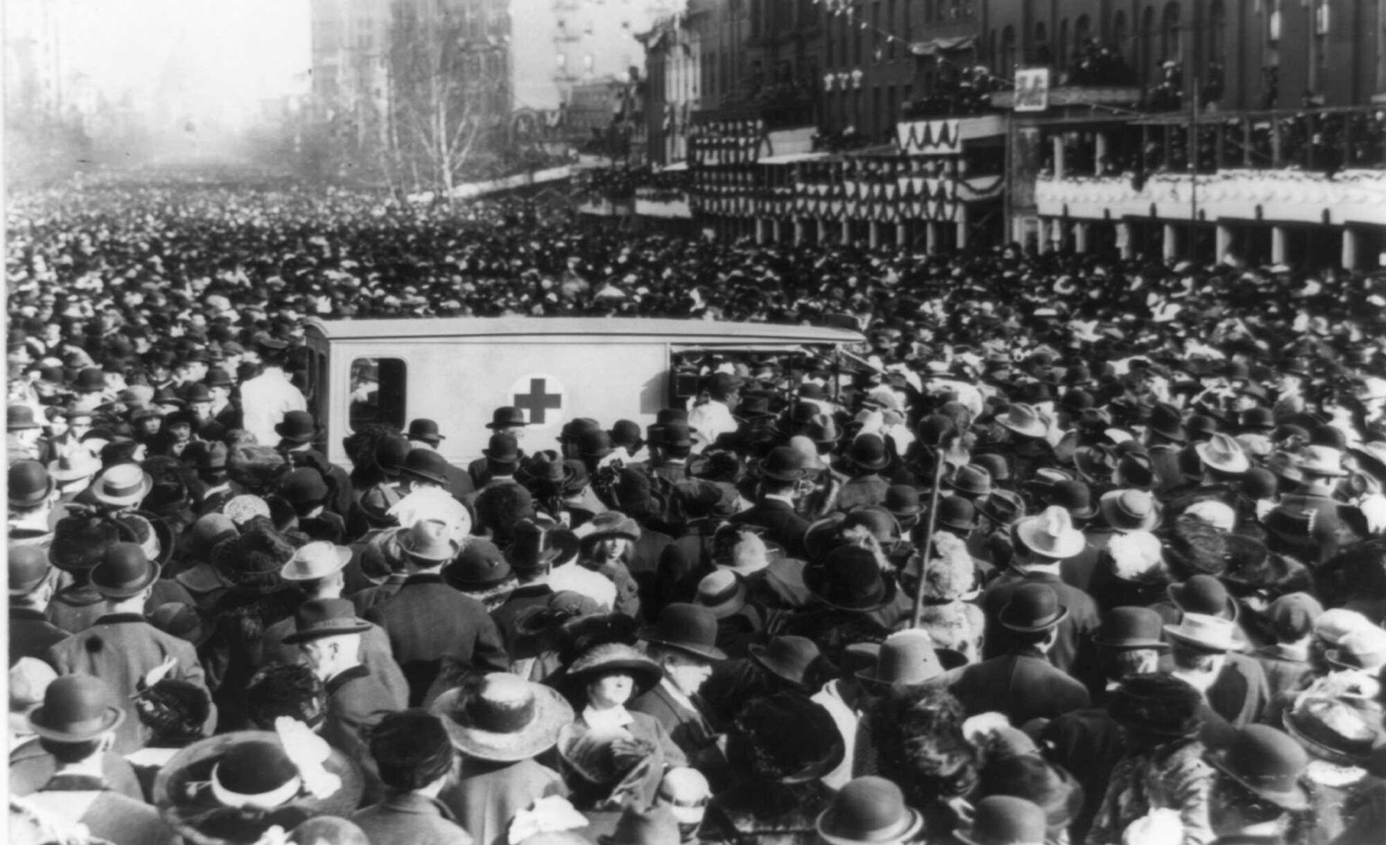 TR-JohnGable-Feature-Women's-suffrage-procession-in-Washington,-D.C.-1913,-March-3,-crowd-around-Red-Cross-ambulance-LOC.jpg