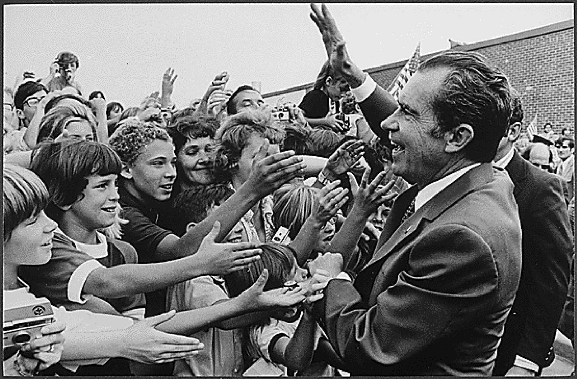 Eisenhower-Richard_Nixon_greeted_by_children_during_campaign_1972.jpg