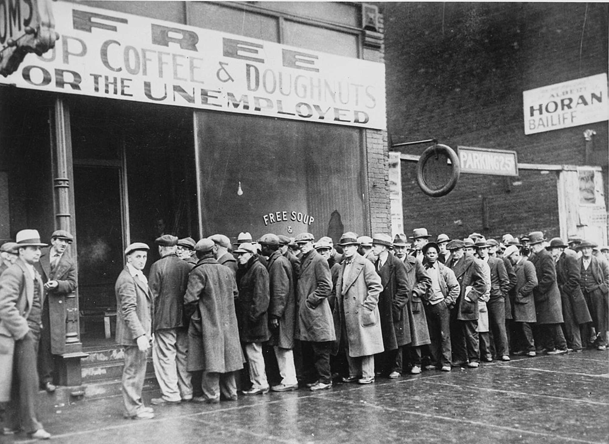 Dustbowl_Unemployed_men_queued_outside_a_depression_soup_kitchen_1931_-_NARA.jpg