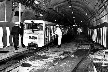 workers boarding an electric car in the Seikan Tunnel, Yoshioka, Japan