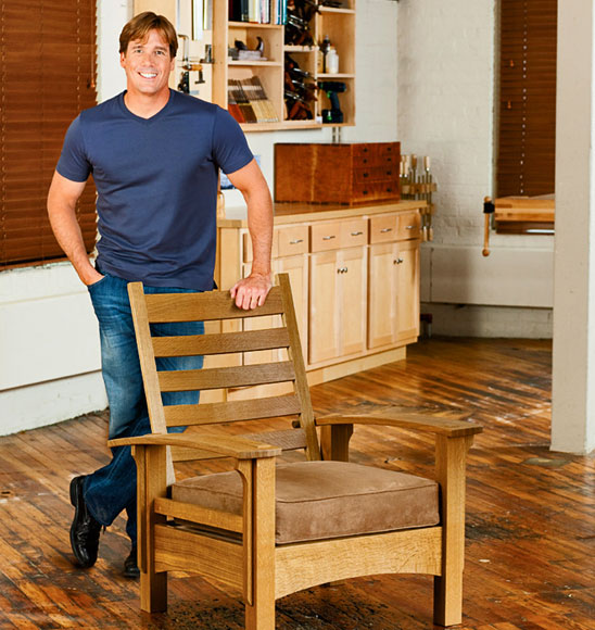Tommy MacDonald standing with an arts and crafts style chair