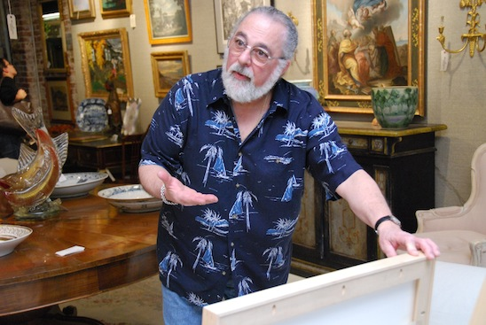 MARKET WARRIORS picker John Bruno looks through art canvases
