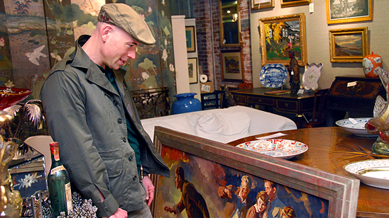 MARKET WARRIORS picker Bob Richter looking through pieces of art