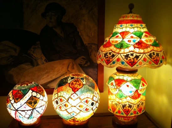 Three colorful lamps, two round and one tall
