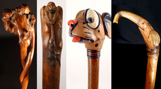 a photograph featuring four wooden folk art walking sticks -- canes carved with intricate handles. From left to right, an abstract rootball, a monkey, a dog, and an elephant