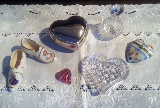 A collection of heart-shaped objects on a lace tablecloth