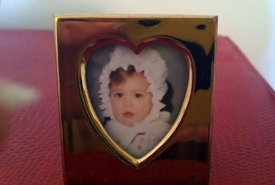 MARKET WARRIORS Miller Gaffney baby photo in a heart-shaped silver frame