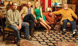 photo of the four pickers on set, surrounded by antiques and vintage objects