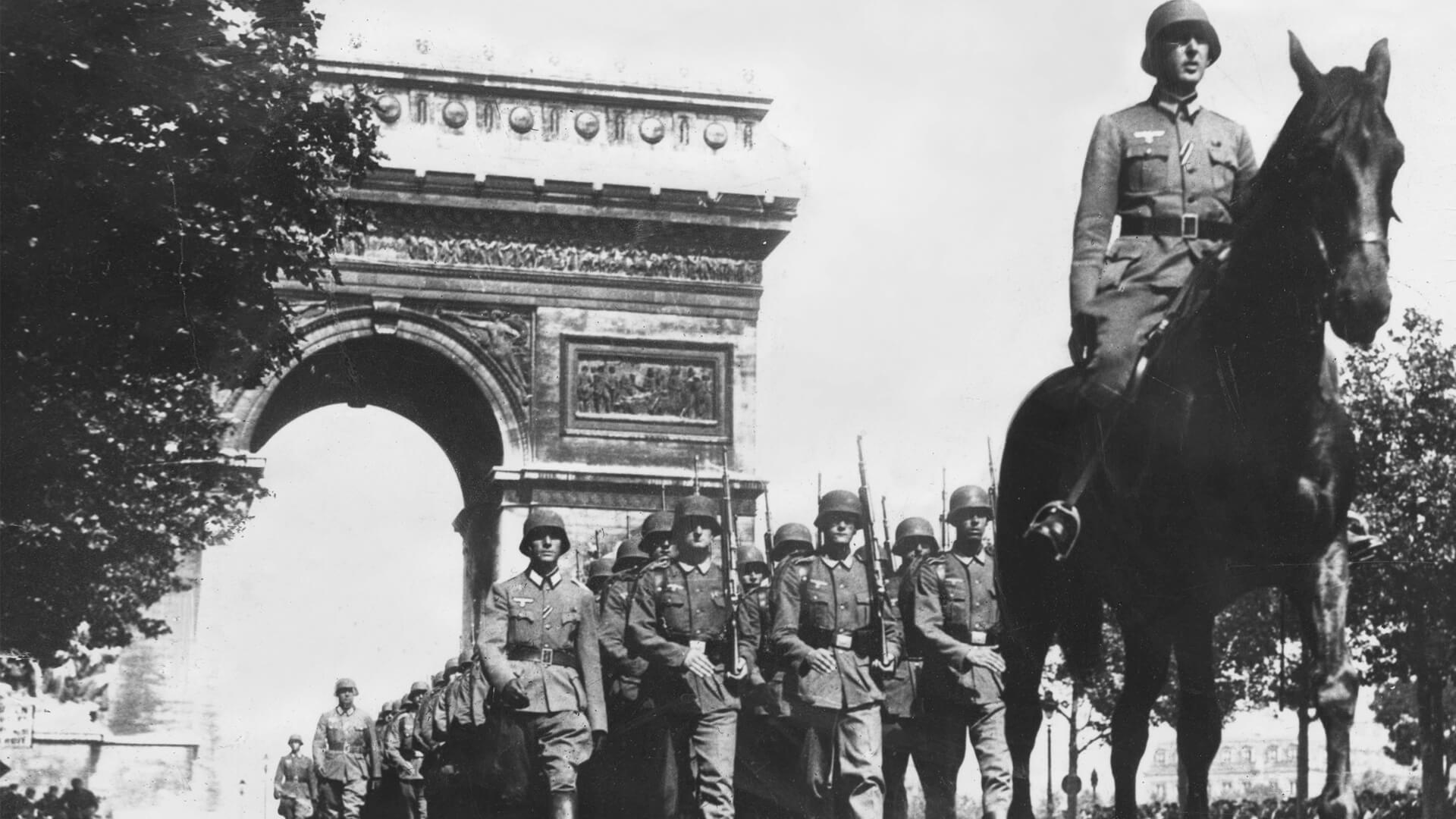 German troops march through the Champs Elysees, Paris, France