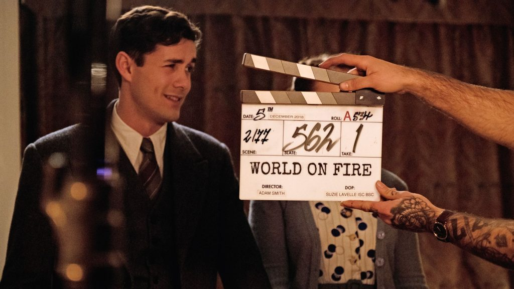 Jonah Hauer-King and Julia Brown prepare for a scene in World on Fire, Season 1
