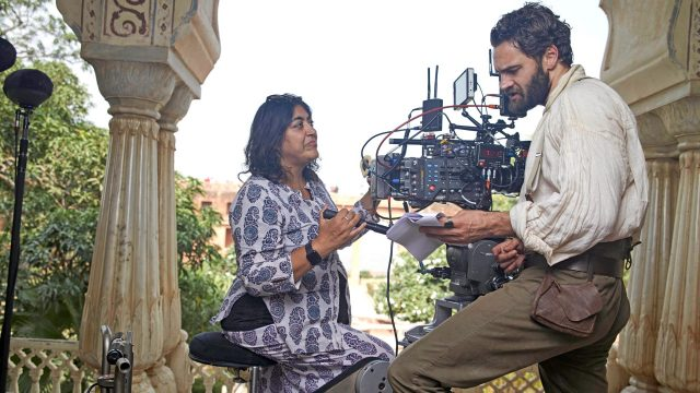 Creator Gurinder Chadha and actor Tom Bateman behind the scenes of Beecham House
