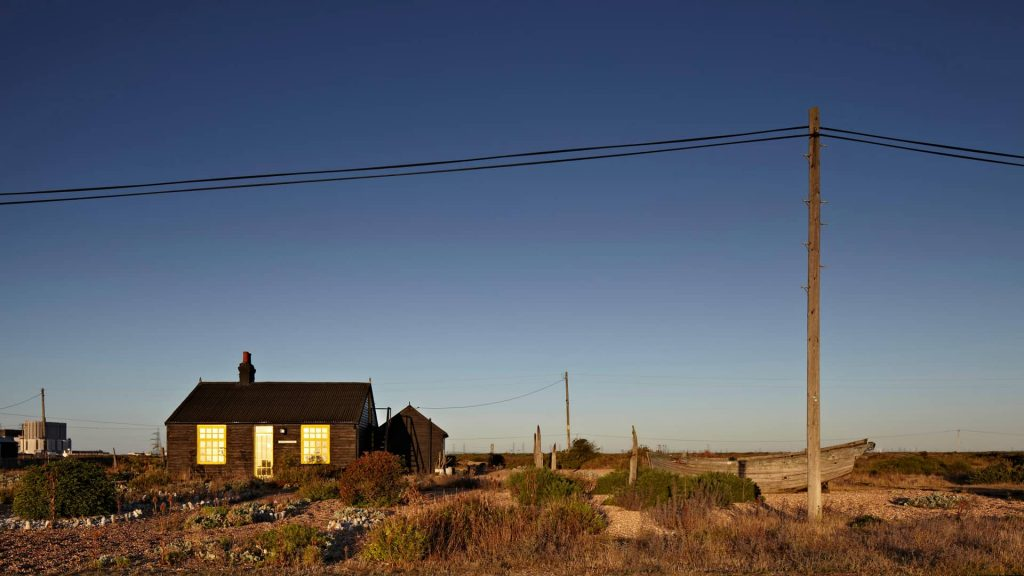 Prospect Cottage, the former home of the late British film director Derek Jarman. In the far-left background, the Dungeness Nuclear Power Station is visible.