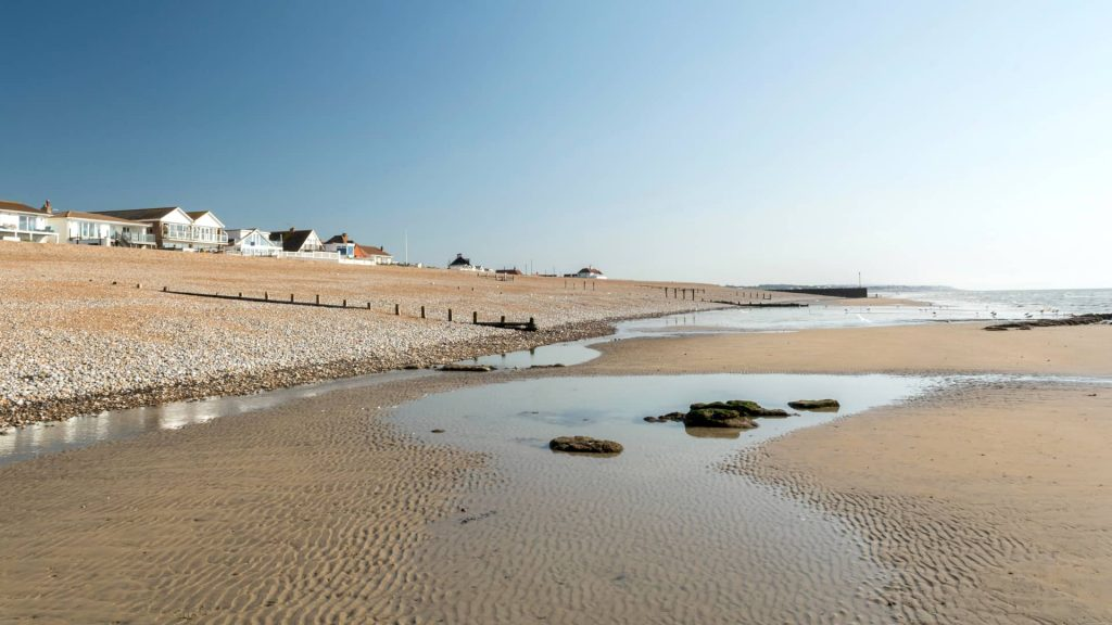 Normans Bay, in East Sussex, has a shingle (rock and pebble) beach, with wide, shallow sand flats exposed at low tide.