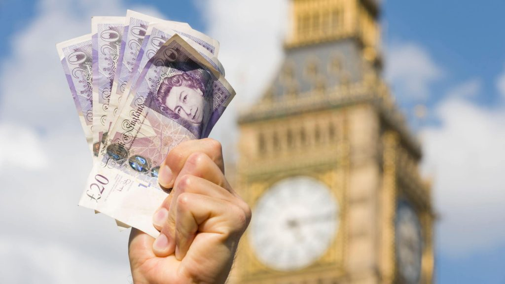 Handful of £20 notes being held up out the House of Commons