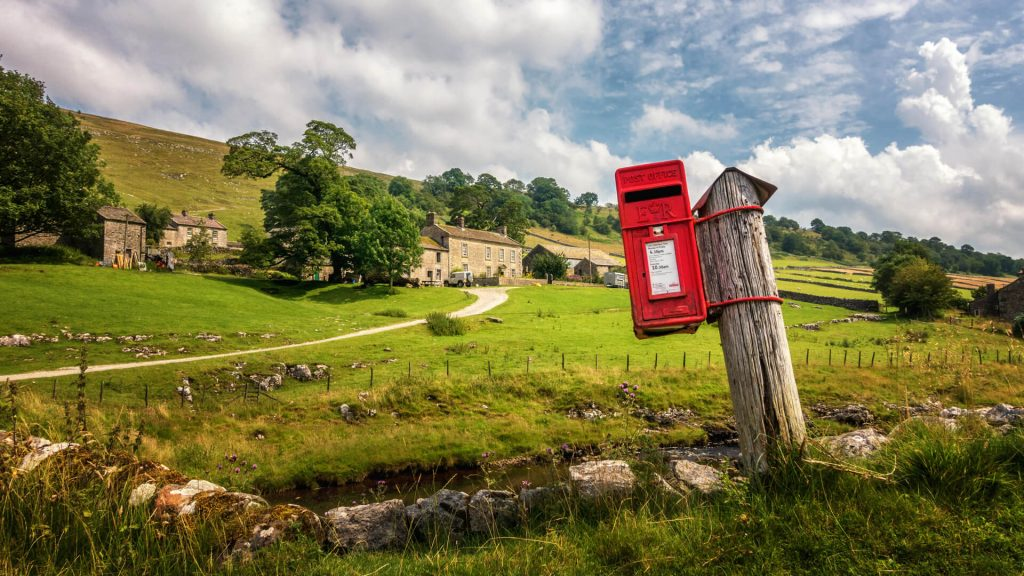 Red postbox in Yorkshire Dales