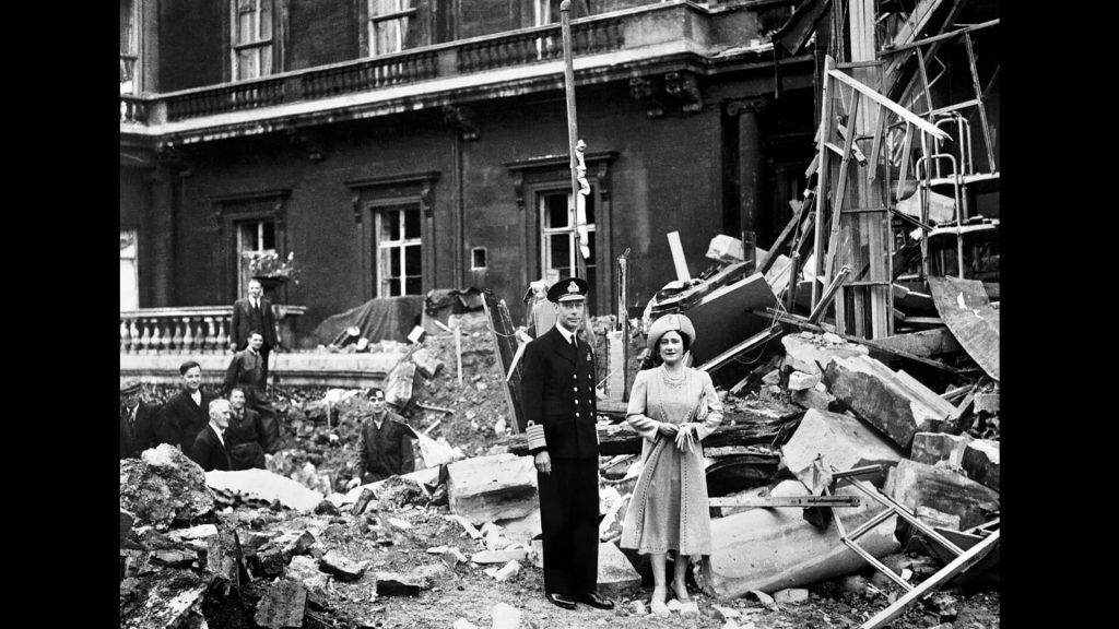British King George and Queen Elizabeth stand amid WW II bomb damage at Buckingham Palace, September 1940
