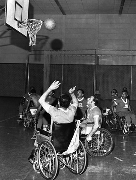 Black and white photo of wheelchair basketball game