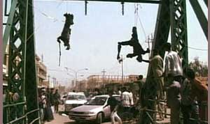 photo of contractors hanging off a bridge in <span class=