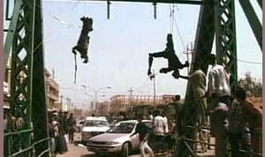 photo of contractors hanging off a bridge in <span class=