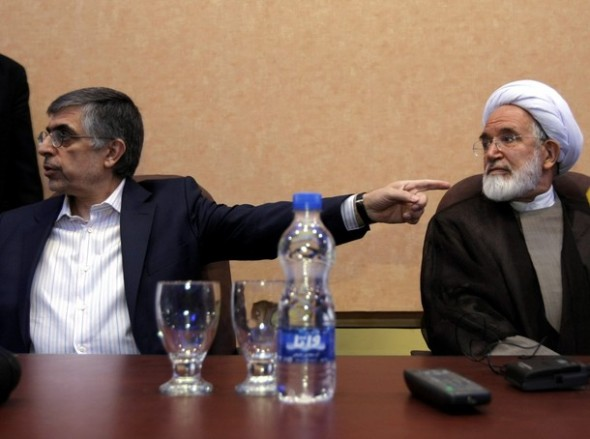 Former Tehran mayor Gholamhossein Karbaschi (L) points at ally Mehdi Karroubi, Iran's former parliament speaker and reformist presidential candidate for upcoming June elections, during a press conference in Tehran on April 28, 2009. Karroubi said that he will not pull out of the presidential race, though he is concerned about possible tweak of votes. BEHROUZ MEHRI/AFP/Getty Images