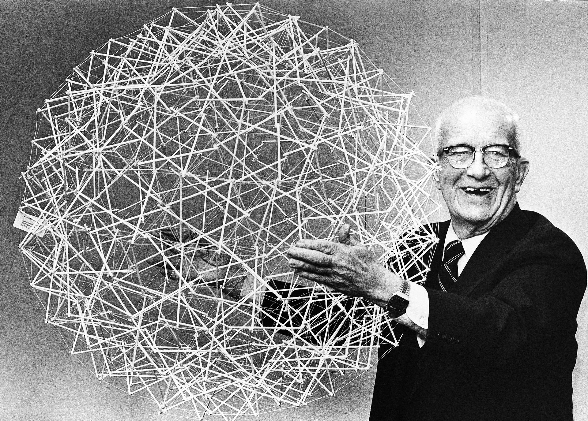 R. Buckminster Fuller holds up a Tensegrity sphere. 18th April, 1979.