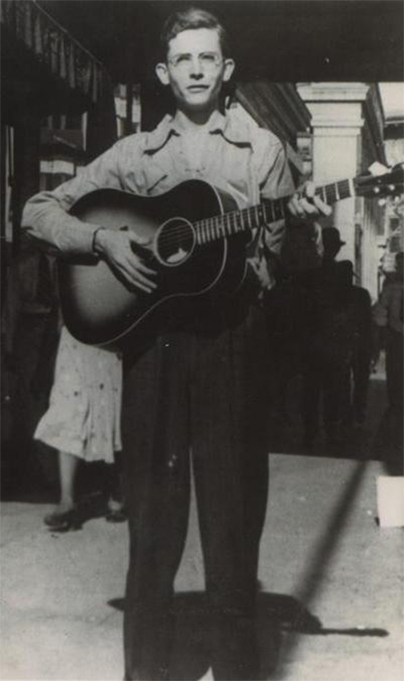 Hank Williams playing guitar in Montgomery, Alabama in 1938.