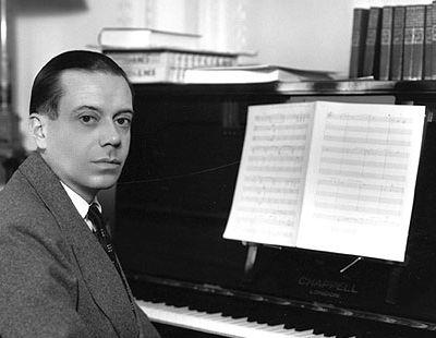 Cole Porter at a piano