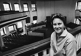 Harper Lee poses for Life magazine in the balcony of the old courthouse in Monroeville, Alabama, May 1961.