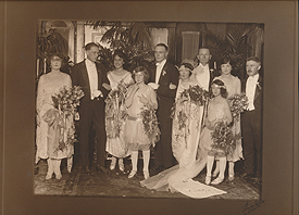 """Red"" Upshaw (pictured fifth from left) and Margaret Mitchell's (pictured sixth from left) wedding photo, September 2, 1922. Upshaw is believed to be the model for the Rhett Butler character in Gone With the Wind. Best man John Marsh (pictured second from left) would become Mitchell's second husband, July 4, 1925, and her editor when writing Gone With the Wind. Also pictured, Mitchell's older brother Stephens (far right). Courtesy of Atlanta History Center."
