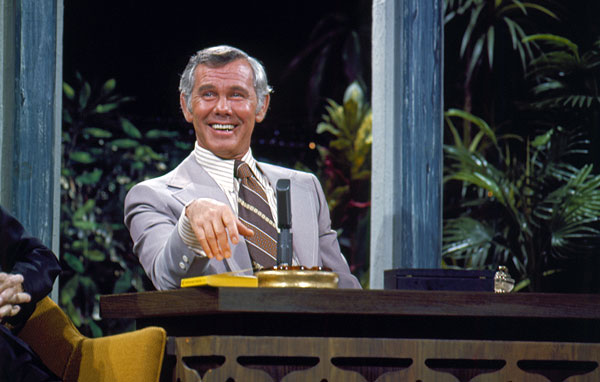 "Johnny Carson at ""The Tonight Show"" desk, circa 1970s. Credit: Courtesy of Carson Entertainment Group"