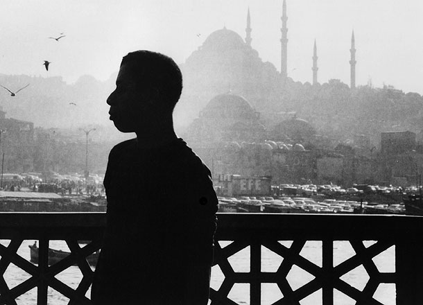 James Baldwin in 1964, against the mosques of Istanbul, Turkey. His home for a total of seven years, Istanbul was a refuge from Western racism -- and the place where he finished Another Country, Blues for Mister Charlie, and Tell Me How Long the Train's been Gone. Photo Credit: Sedat Pakay. Copyright 1989, 2013 DKDmedia