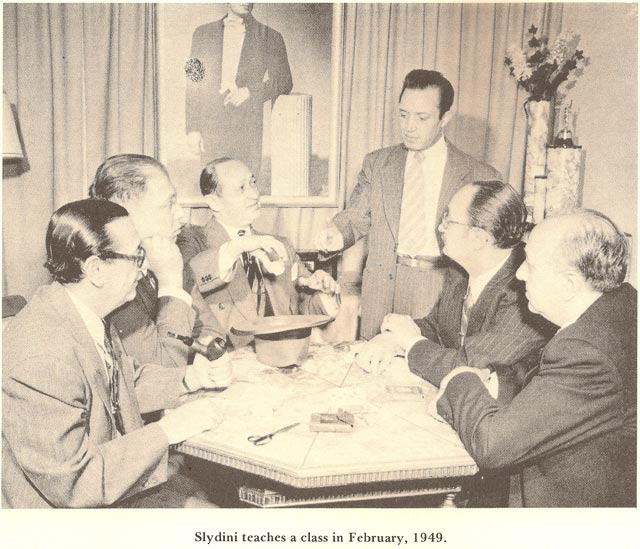 Sydini teaching Max Katz, to his right. Courtesy D. Robbins & Co.