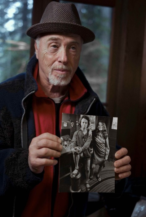 Big Brother and the Holding Company drummer Dave Getz, holding a photo of himself with Janis Joplin