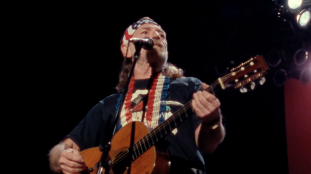Willie Nelson performing at Nassau Coliseum in Uniondale, N.Y., in 1990 with The Highwaymen. Screenshot from The Highwaymen: Friends Till The End. Courtesy of Sony Music Entertainment.