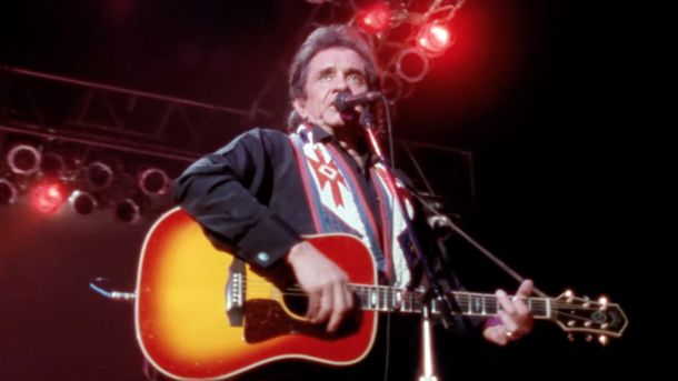Johnny Cash performing at Nassau Coliseum in Uniondale, N.Y., in 1990. Screenshot from The Highwaymen: Friends Till The End. Courtesy of Sony Music Entertainment.