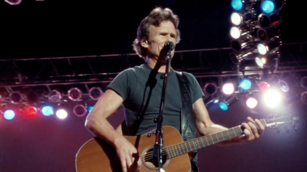 Kris Kristofferson performing at Nassau Coliseum in Uniondale, N.Y., in 1990 with The Highwaymen. Screenshot from The Highwaymen: Friends Till The End. Courtesy of Sony Music Entertainment.