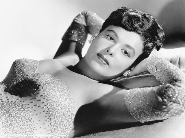 Lena Horne poses in a sequined gown.