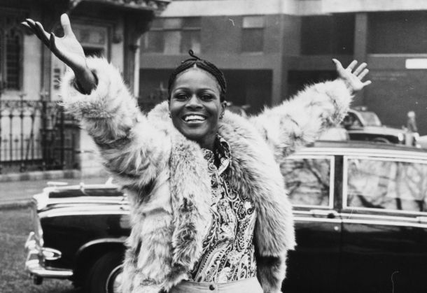 Portrait of Academy Award winning American actress Cicely Tyson smiling and raising her arms in the air during a visit to London, February 19th 1973.