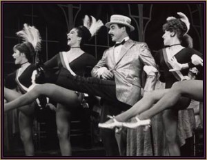 """Sid Caesar and dancers in """"Little Me."""""""